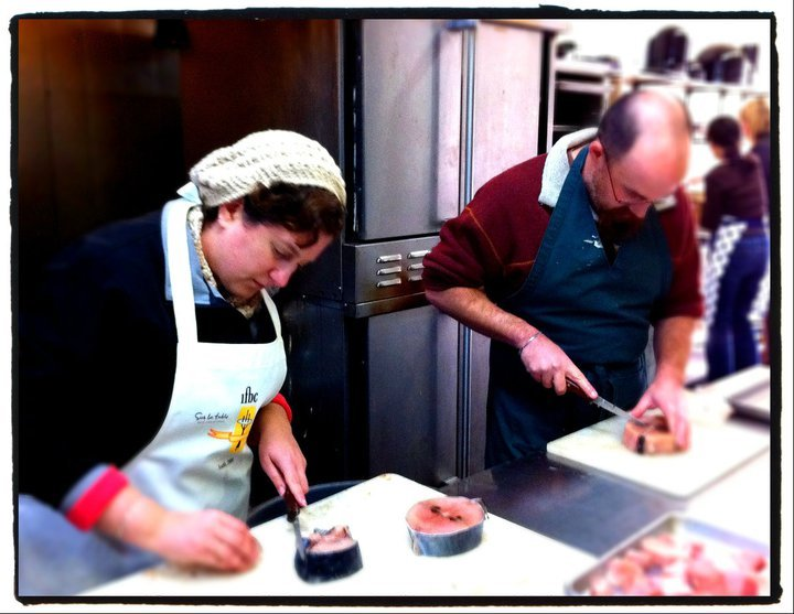 SFS board member, Patricia Eddy and her husband, John Eddy - both of cooklocal.com - breaking down tuna steaks.