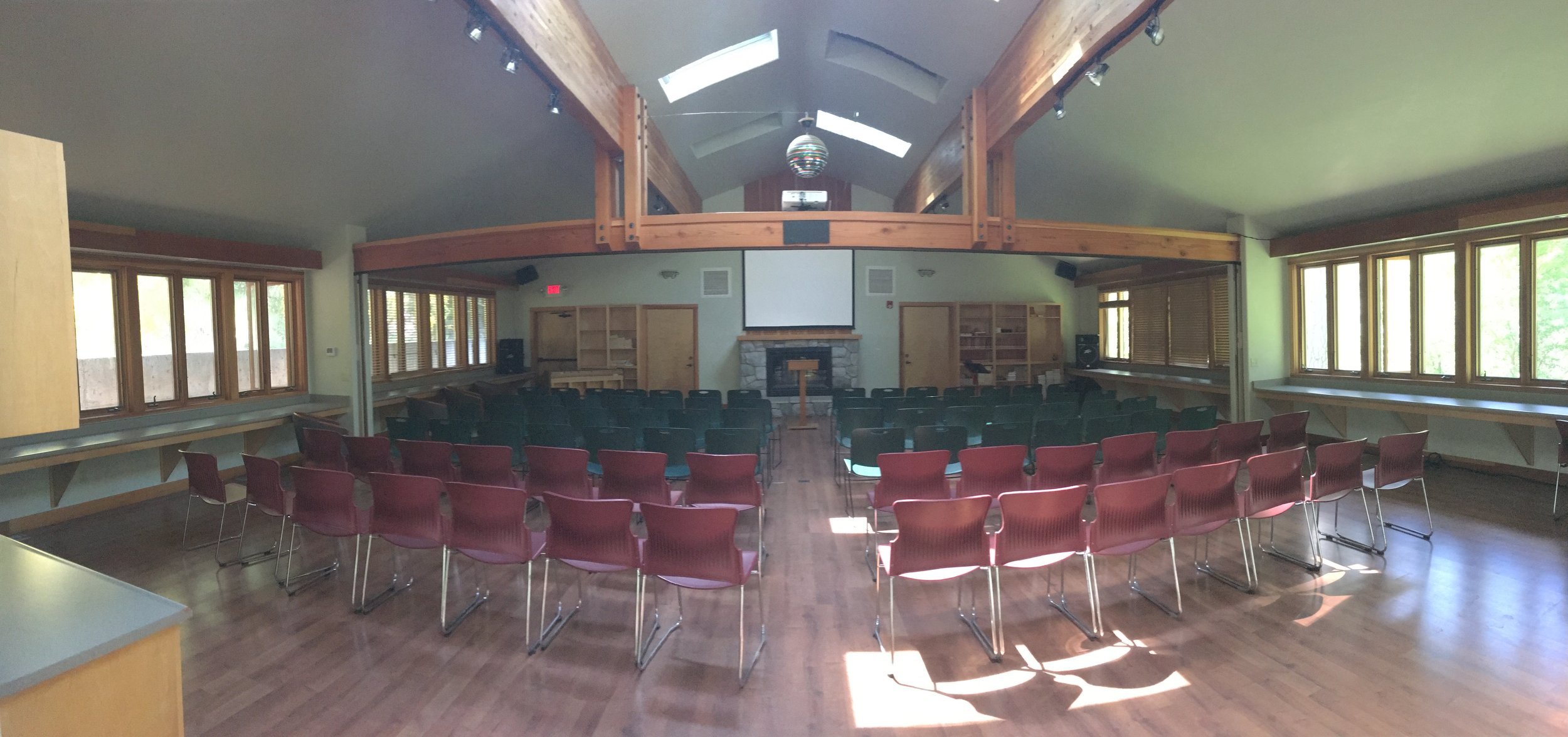 Camsey Victory Chapel - A comfortable, mid-size room that creates an intimate atmosphere for groups up to 90 people. Equipped with a sound system, LCD projector, and ceiling-mounted screen. This space also features a gas fireplace and room divider (if needed).