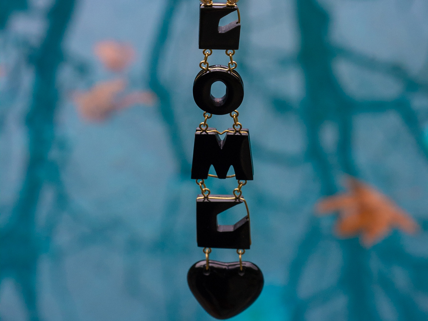Special black jade necklace contains the client's hidden message to their love.