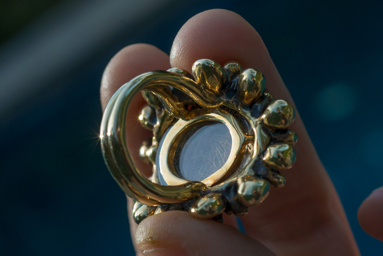 Scarab ring with a lock of the client's granddaughter's hair embedded in the back
