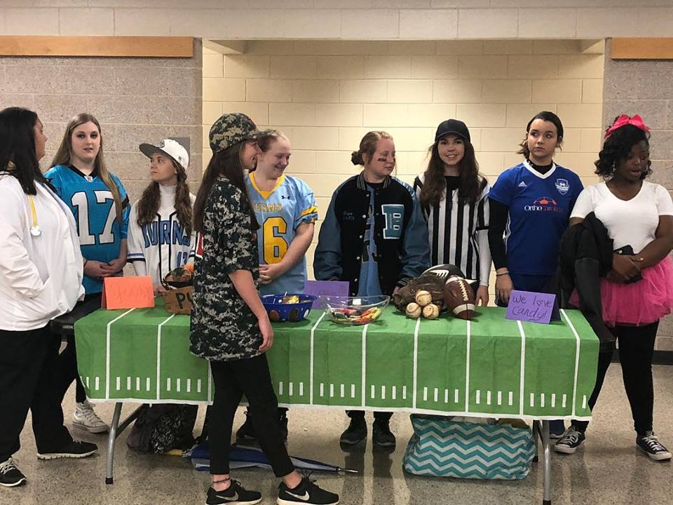 Some Burns High students dressed in their favorite athletic gear to visit NSS for a Halloween treat