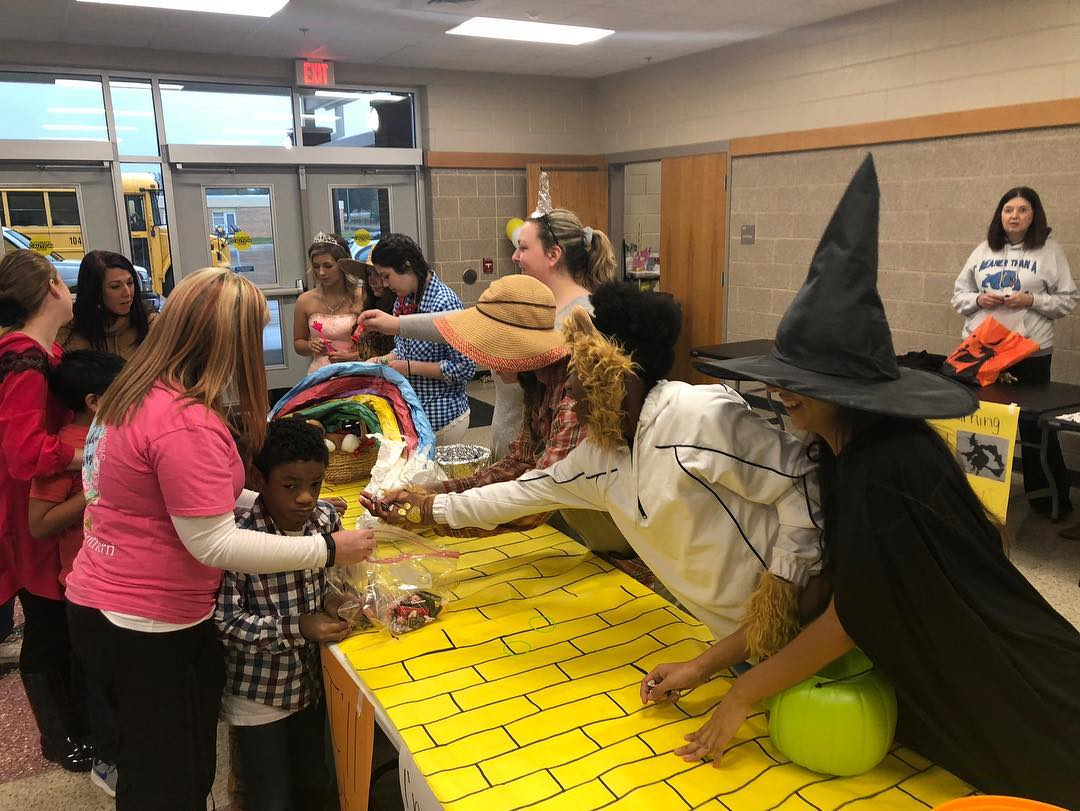 North Shelby students follow the yellow brick road as they trick-or-treat with Burns High students