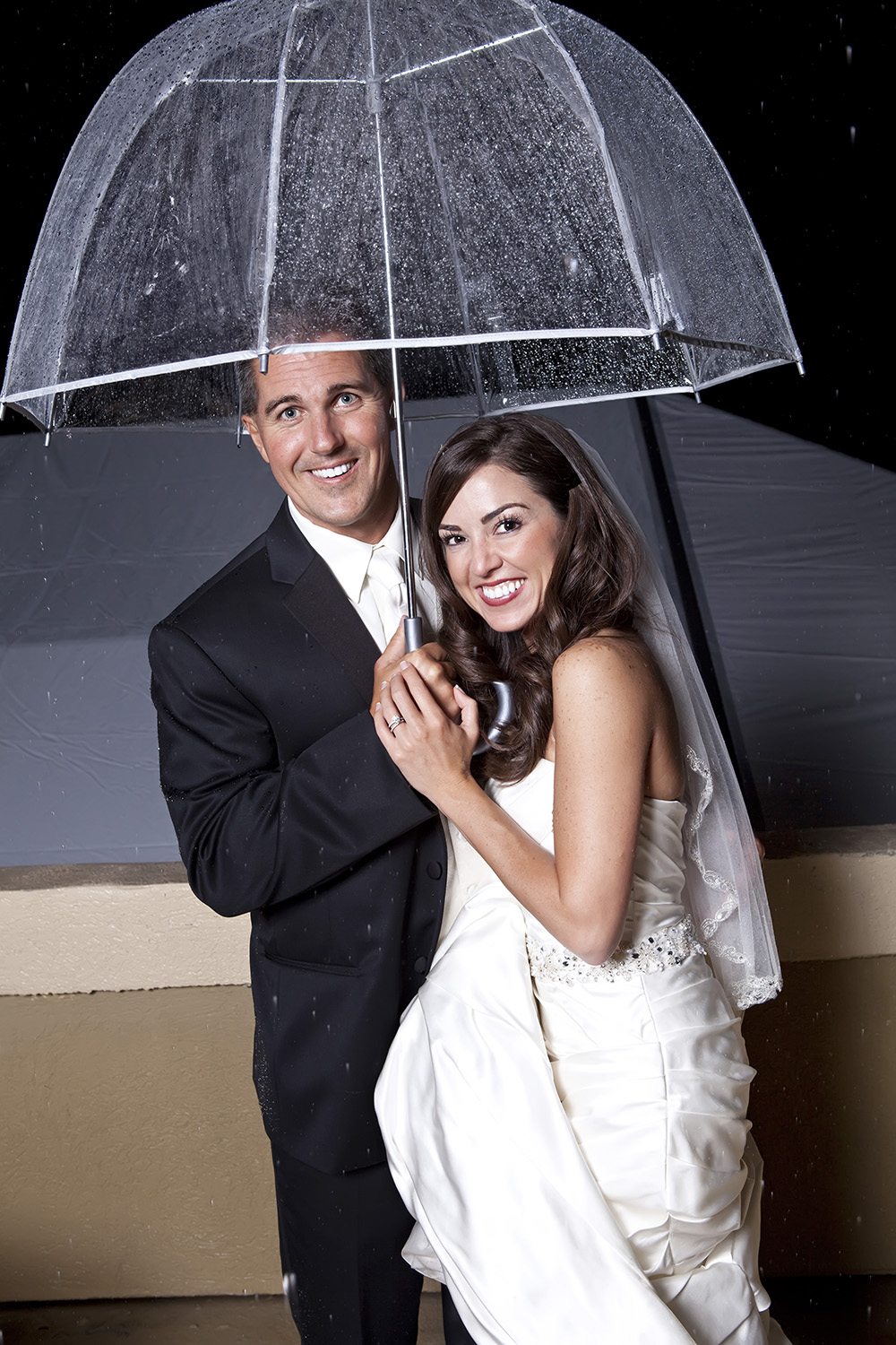 Stormy day happy wedding couple