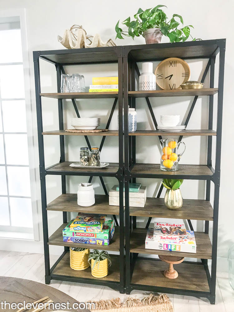 A tall bookcase filled with coastal accessories for Alyssa's room