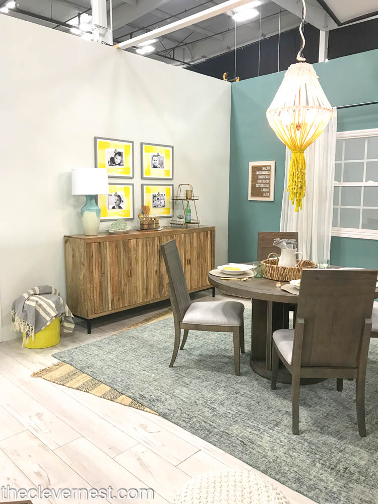yellow and teal coastal style dining room with a buffet