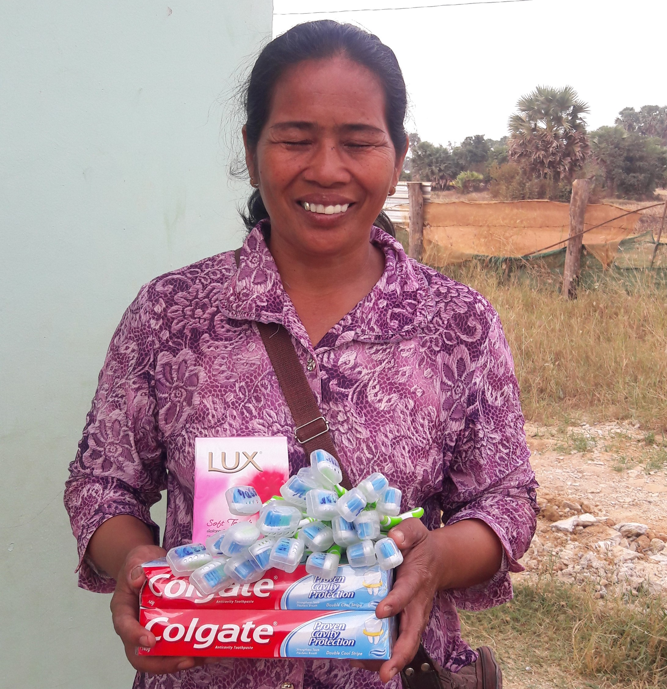Un Nath collects soap, toothpaste and toothbrush for oral healthcare for preschool students.