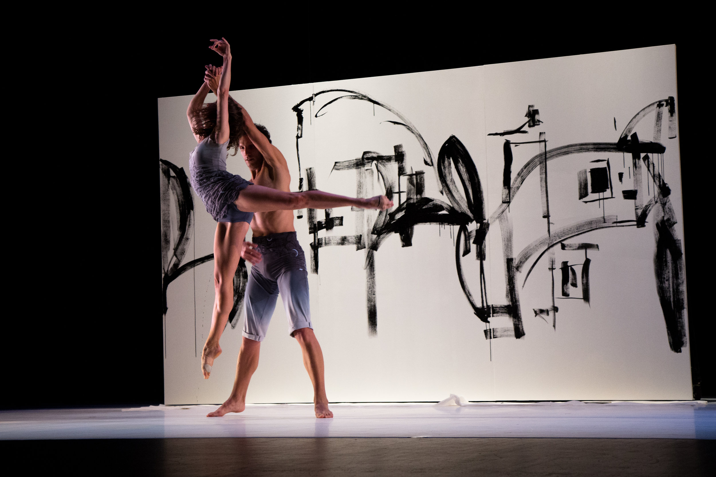 Ashley Flaner and Domenico Luciano in Dekkers'  Colouring,  artwork by Enrique Quintero, costume design by Susan Roemer, photo by Tricia Cronin