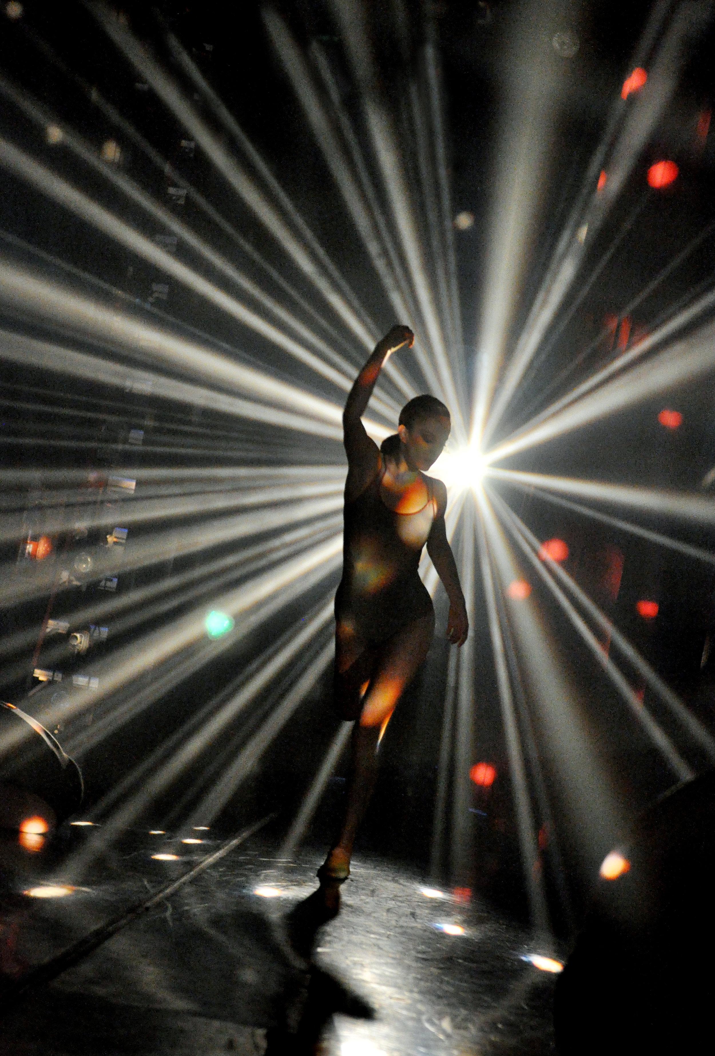Alessandra Ball in Dekkers'  Milieu,  lighting design by David Robertson, photo by Natalia Perez