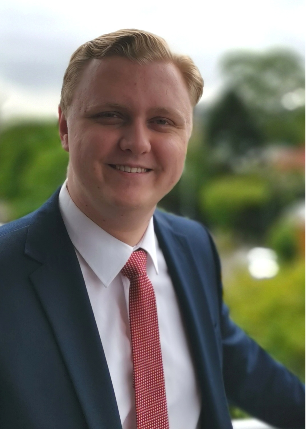 Qld - Thomas Wealleans Profile Headshot.png