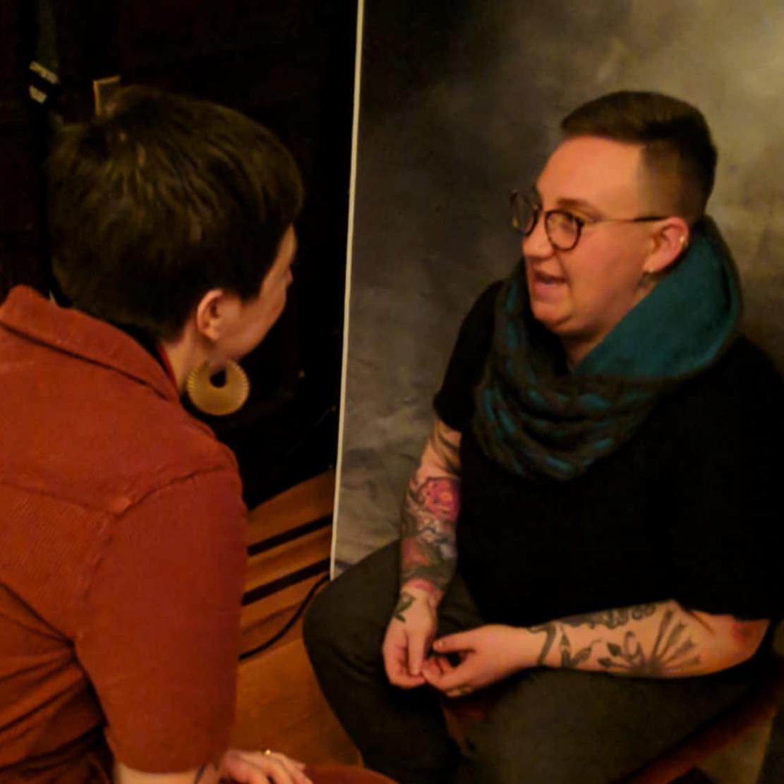Photographer Sarah Shalene Guilbeaux consults at the QueerCut portrait party.