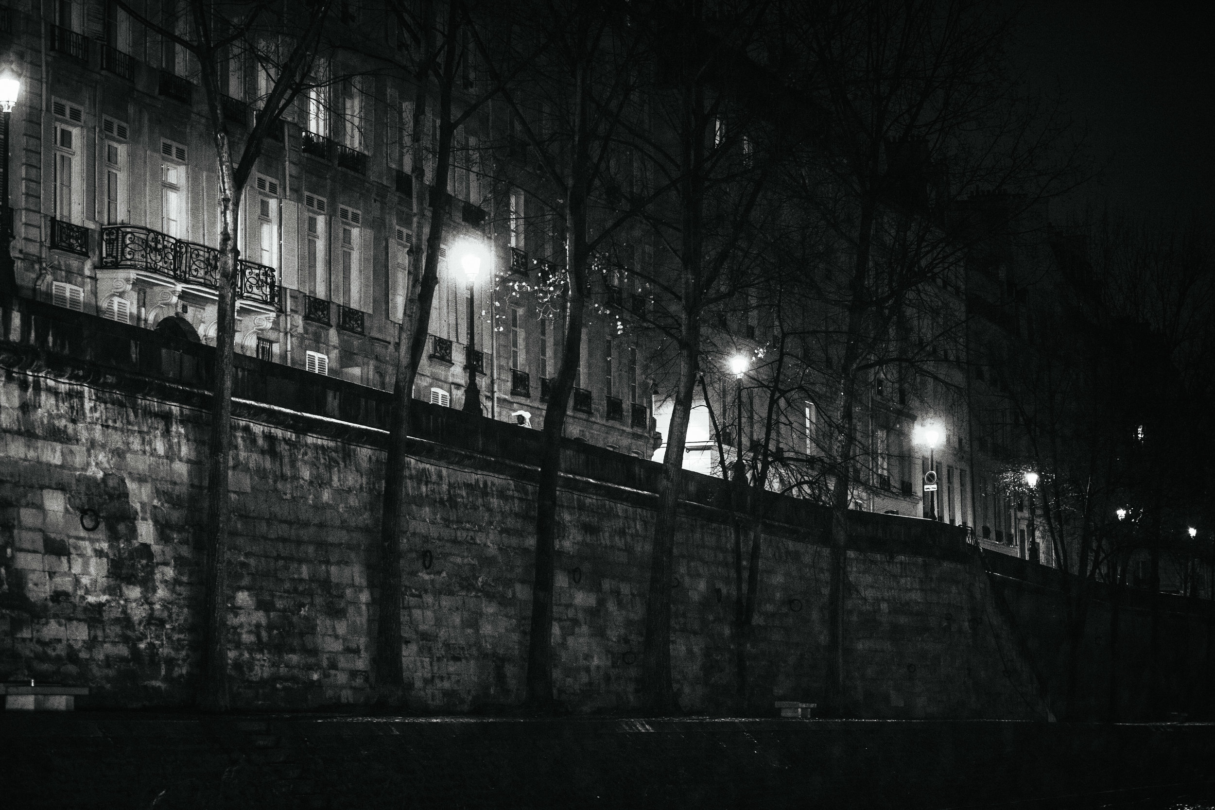 Street lamps along banks of the Seine River in Paris.