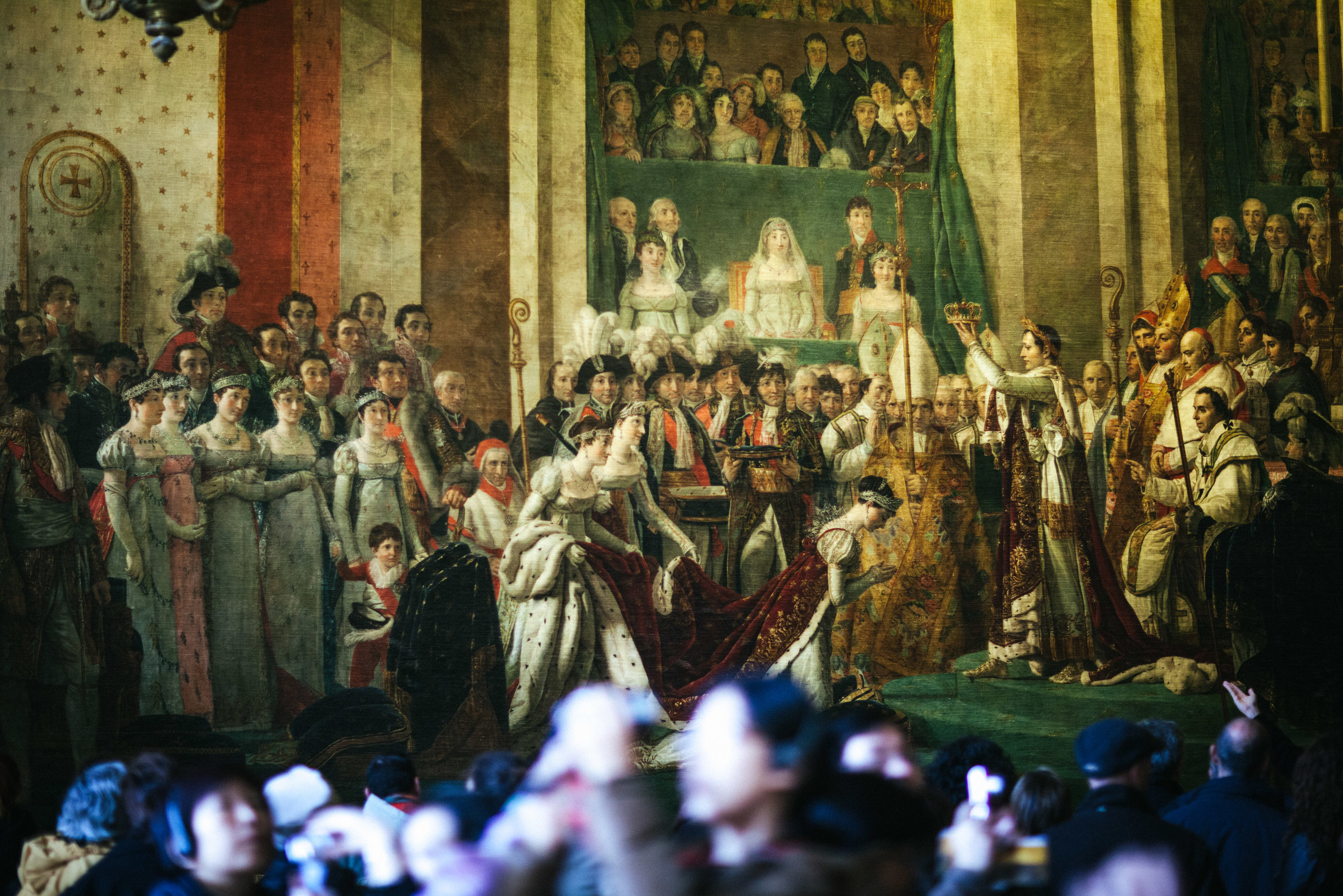 The Coronation of Napoleon is painted by Jacques-Louis David - Napoleon's official painter. This 10 x 6 metre tall painting seen in the Palace of Versailles is actually a replica. The actual painting is exhibited in the Louvre.