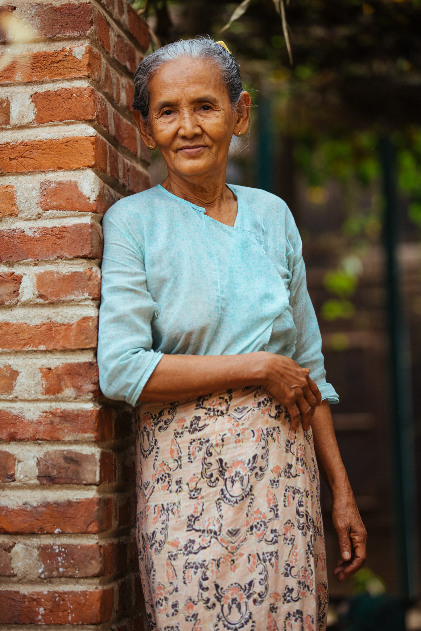 An elderly woman agrees to be photographed. Perhaps due to their religious nature, the Burmese people are naturally warm-hearted and kind spirited.