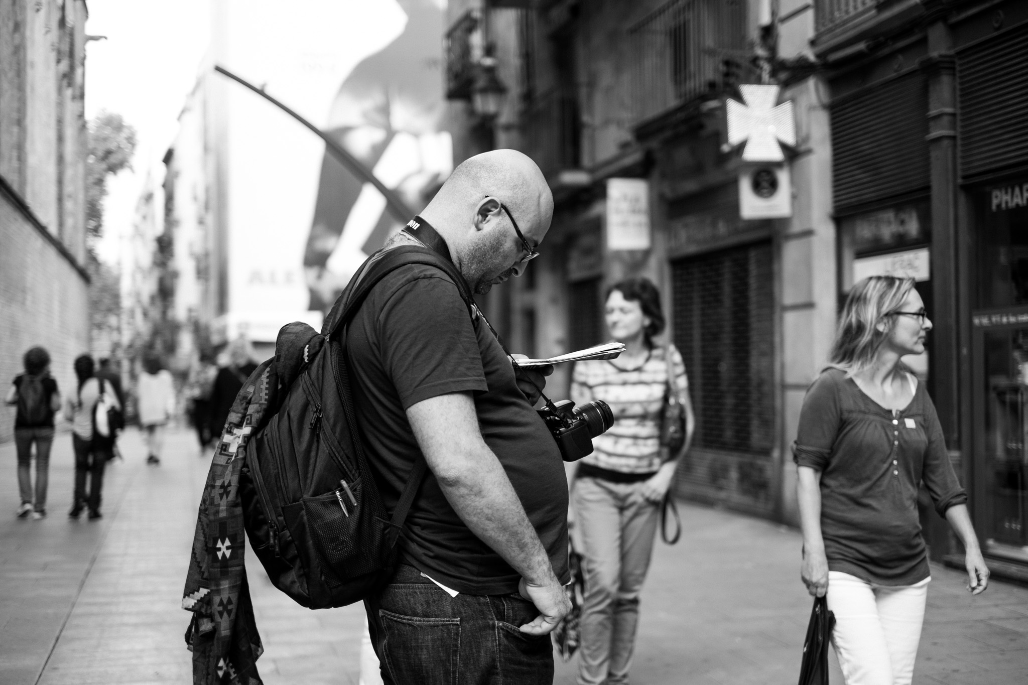 Photographed this very touristy-looking tourist finding his way about the city.