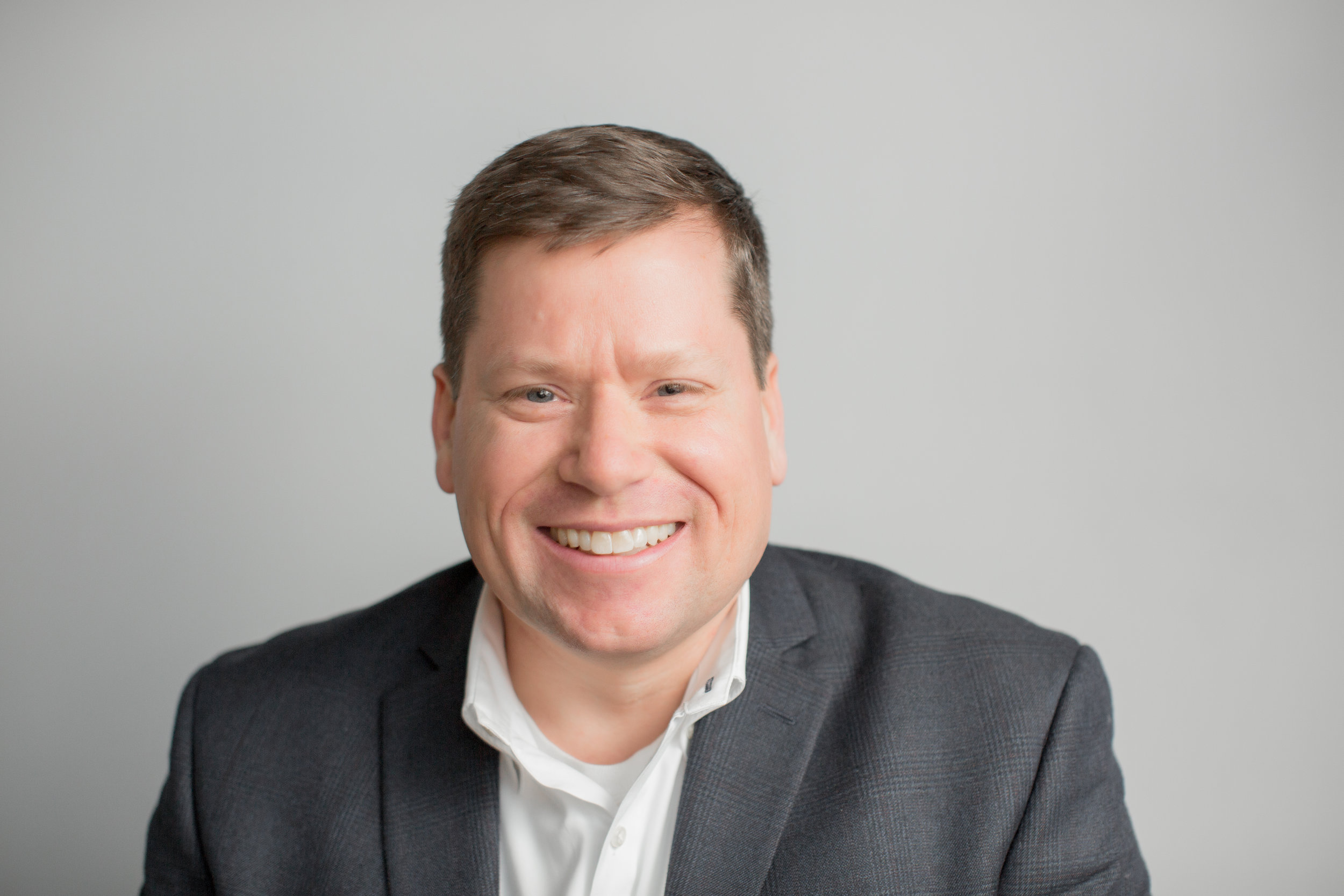 Even in corporate settings, I work to draw out a bit of personality from each person who sits in front of my camera. Boston headshot photographer, executive, professional, LinkedIn photos.