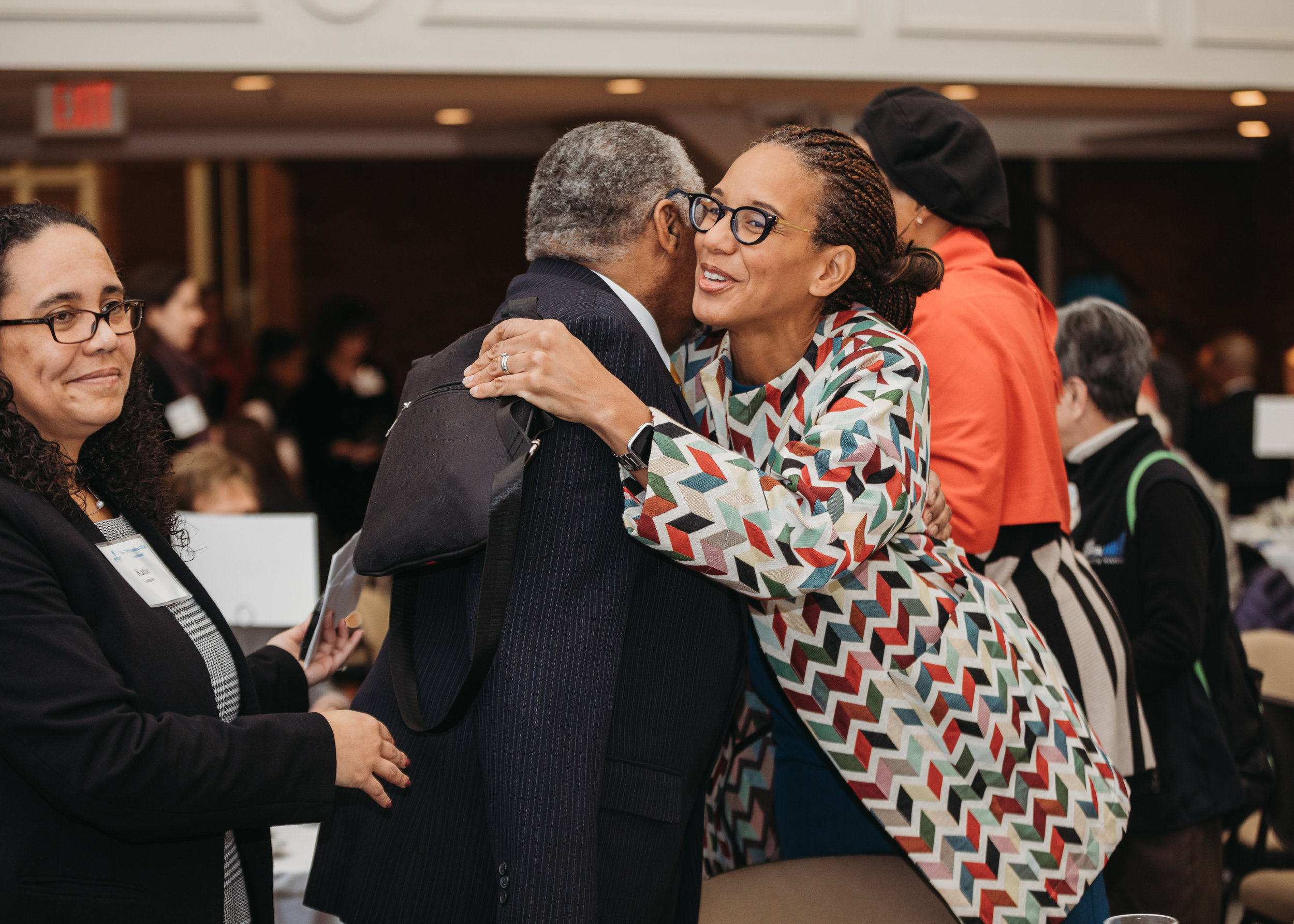 Earl Avery greeting friends and family at the MLK Luncheon/retirement celebration. Boston photographer Joy LeDuc. Capturing emotion at corporate events.