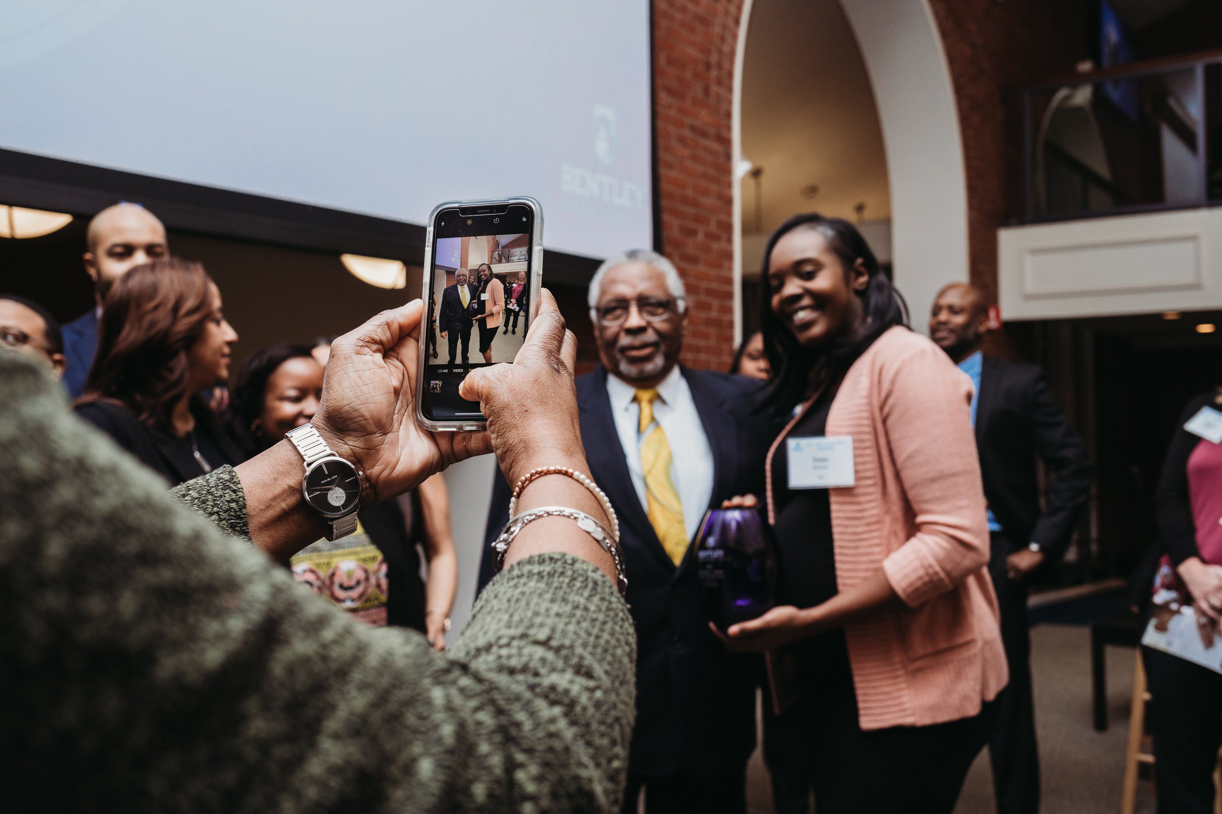 Taking pictures with Earl Avery after the celebration to honor his legacy at Bentley University. Higher education event photography.