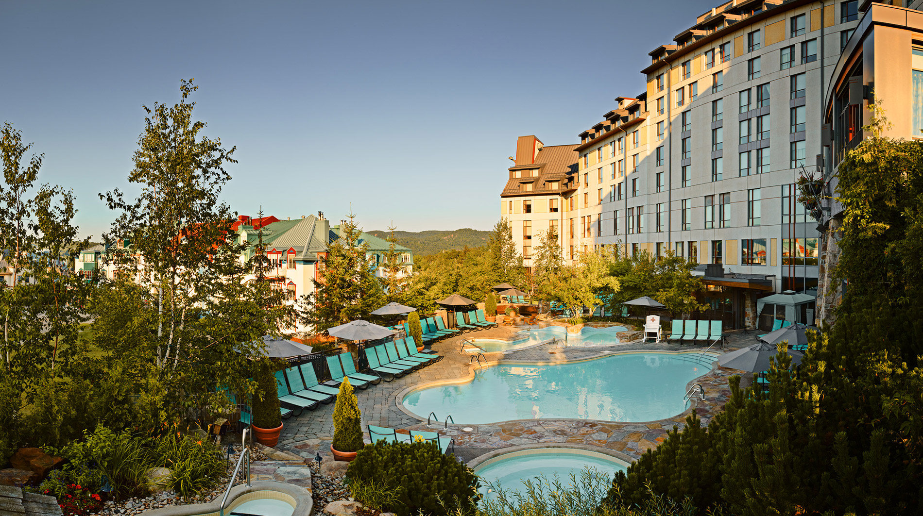 Fairmont-Tremblant-summer-pool-panoramic.jpg