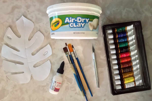 Supplies - - Air-dry OR oven-bake clay (I used air dry for this tutorial)- Sculpey Glaze- Paint Brushes- X-Acto Blade- Sandpaper- Acrylic Paint- Monstera Stencil(I made my own stencil, you can download it here!)