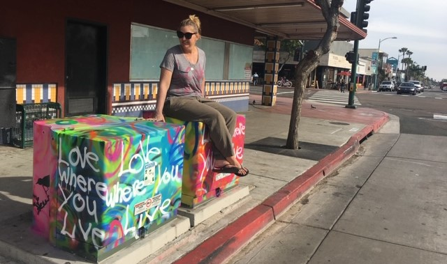 Kim Curran in North Park with one of her iconic Love Where You Live utility boxes