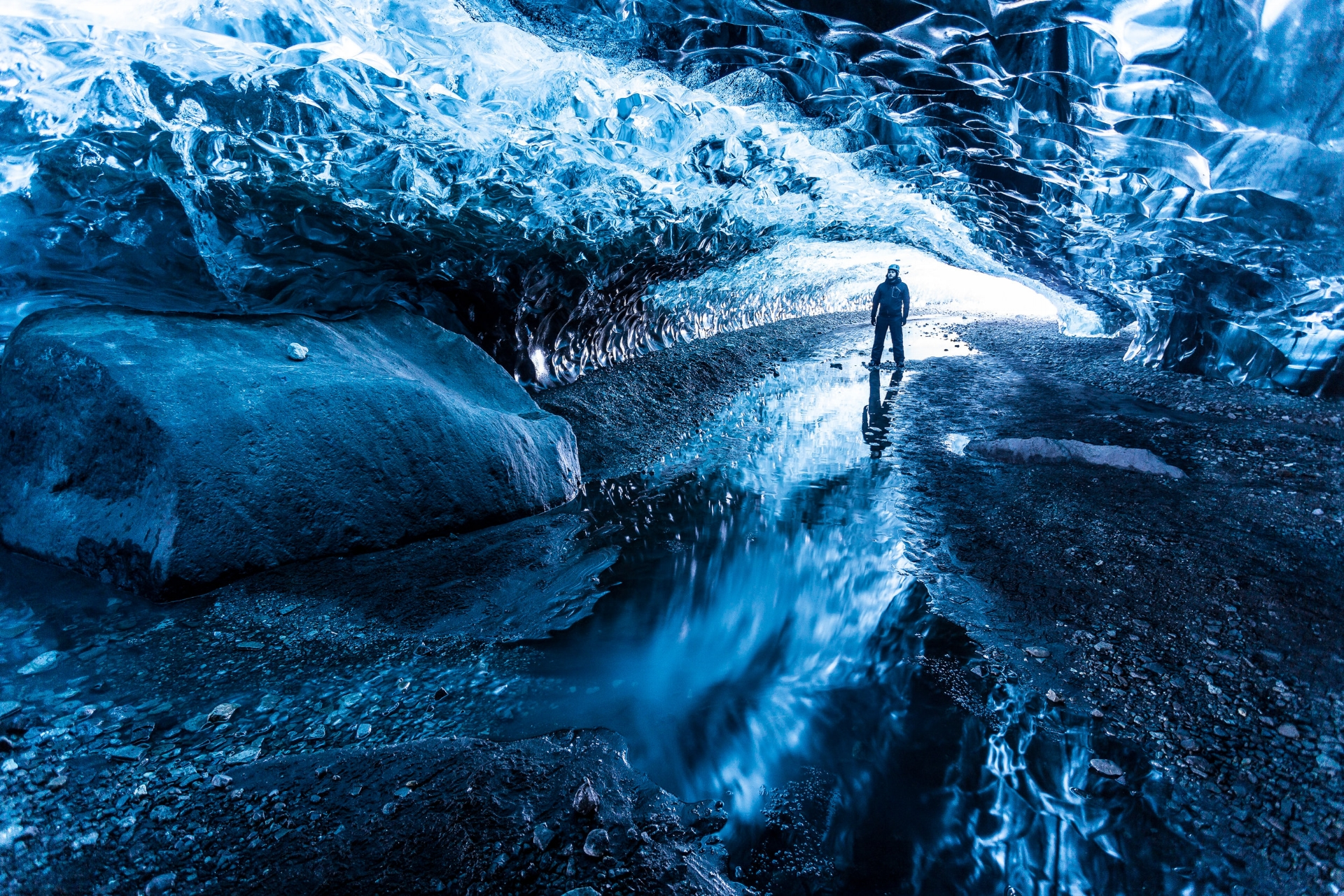 A beautiful blue ice cave underneath Breiðamerkurjökull, a glacier tongue of Vatnajökull.