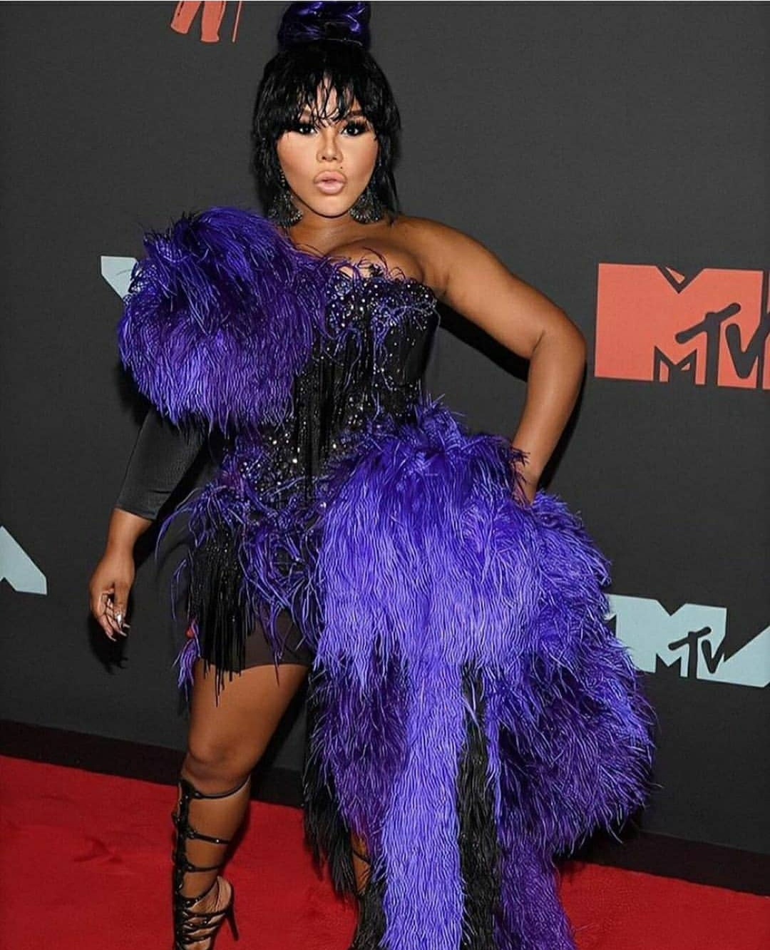 Lil Kim is wearing The Blonds