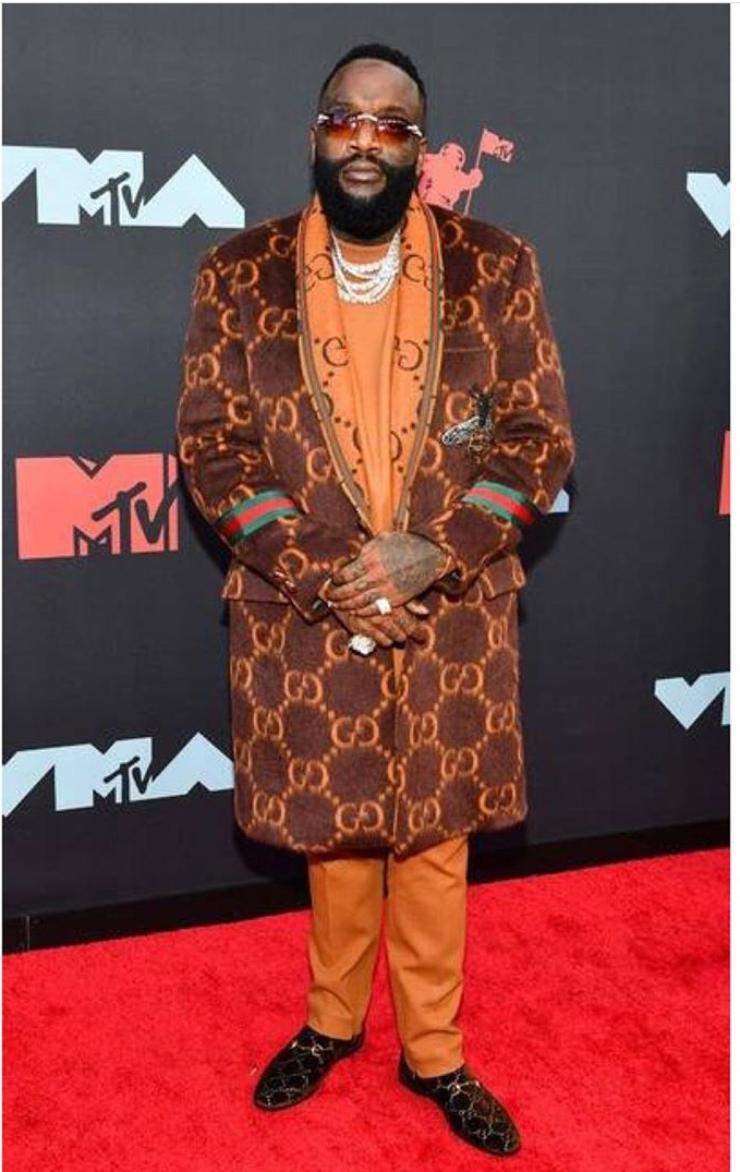 Rick Ross is wearing Gucci