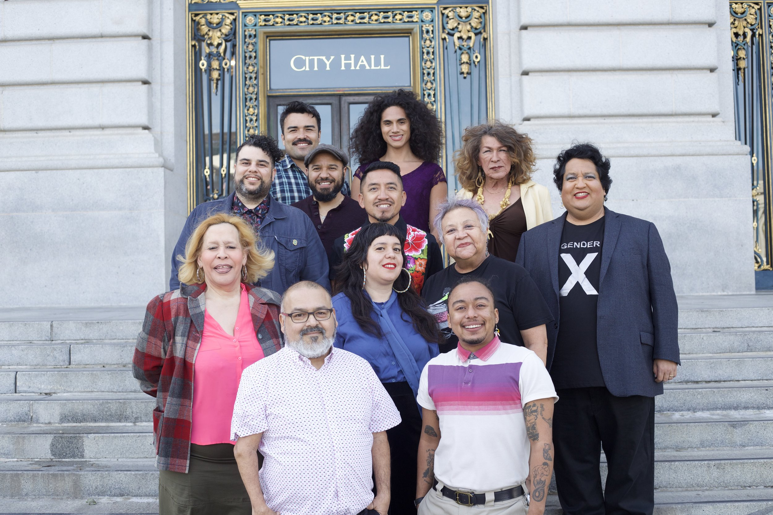 Curator Tina Valentin Aguirre and exhibition collaborators. Top row: Fabian Echevarria and Shane Zaldivar. Second row: Prado Gomez and Donna Personna. Third row: Rigoberto Marquez, Angel Fabian and Tina Valentin Aguirre. Fourth row: Adela Vazquez, Natalia Vigil and Olga Talamante. Bottom row: Lito Sandoval and Mason J. Smith. Photo by Fabian Echevarria/Bill Jennings.