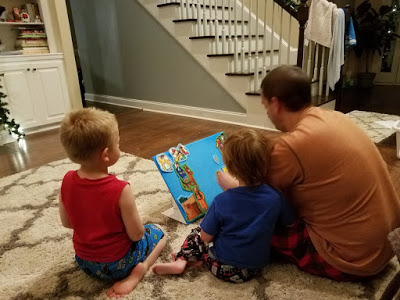 Seneca Foster Daddy Reads to his foster son.