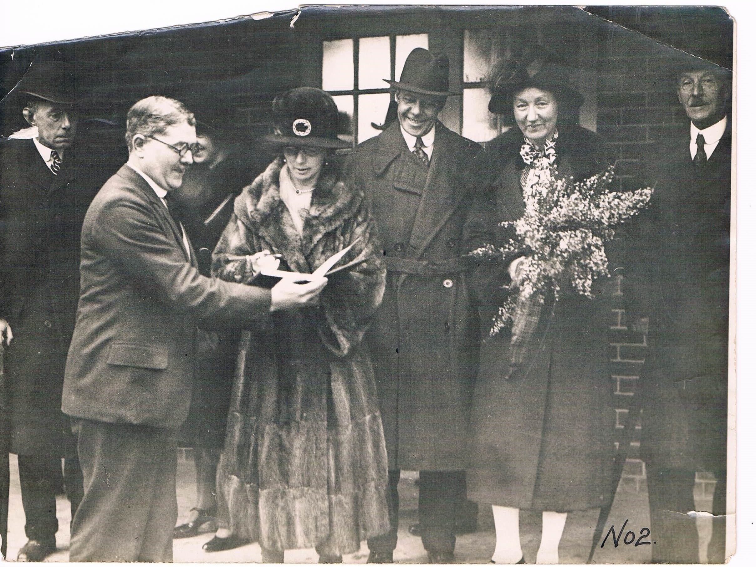 Opening of Stanmore School by Duchess of Atholl. Headmaster, G. H. Barker holding book.