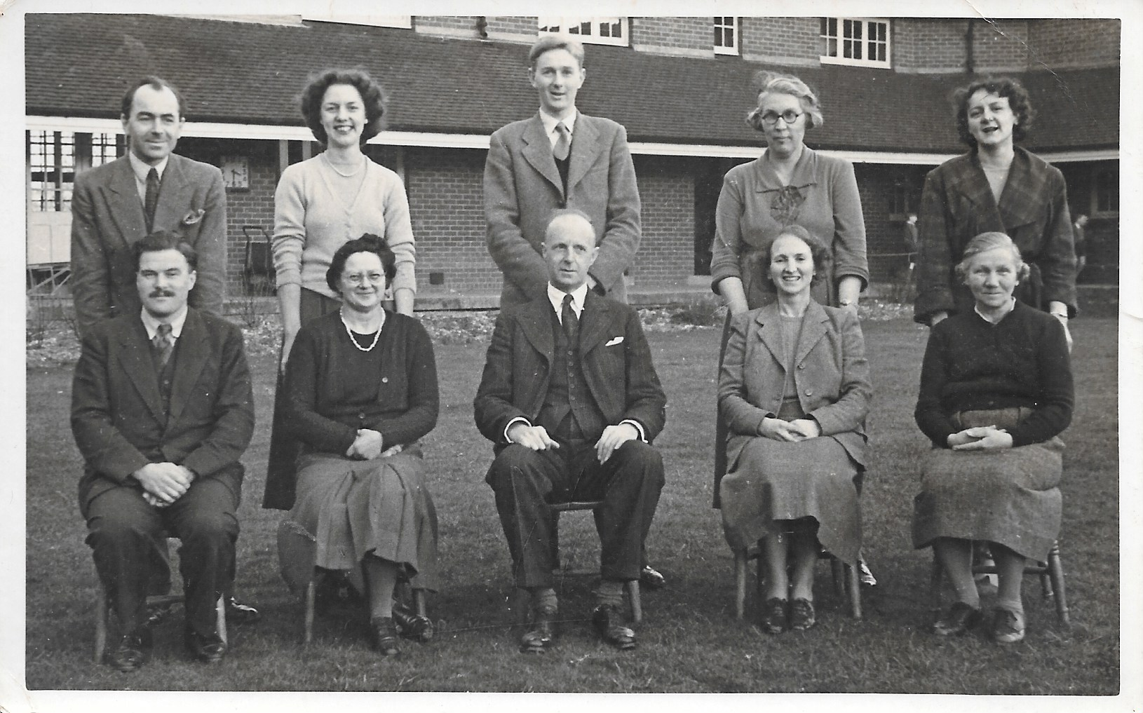 Mr King in the centre with Miss Glover second from the right in the back row.