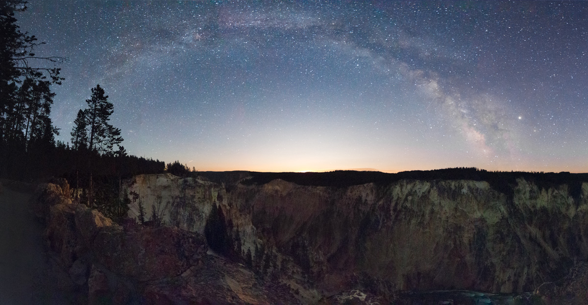 Milky Way rising before gibbous Moon over Grand Canyon of Yellowstone