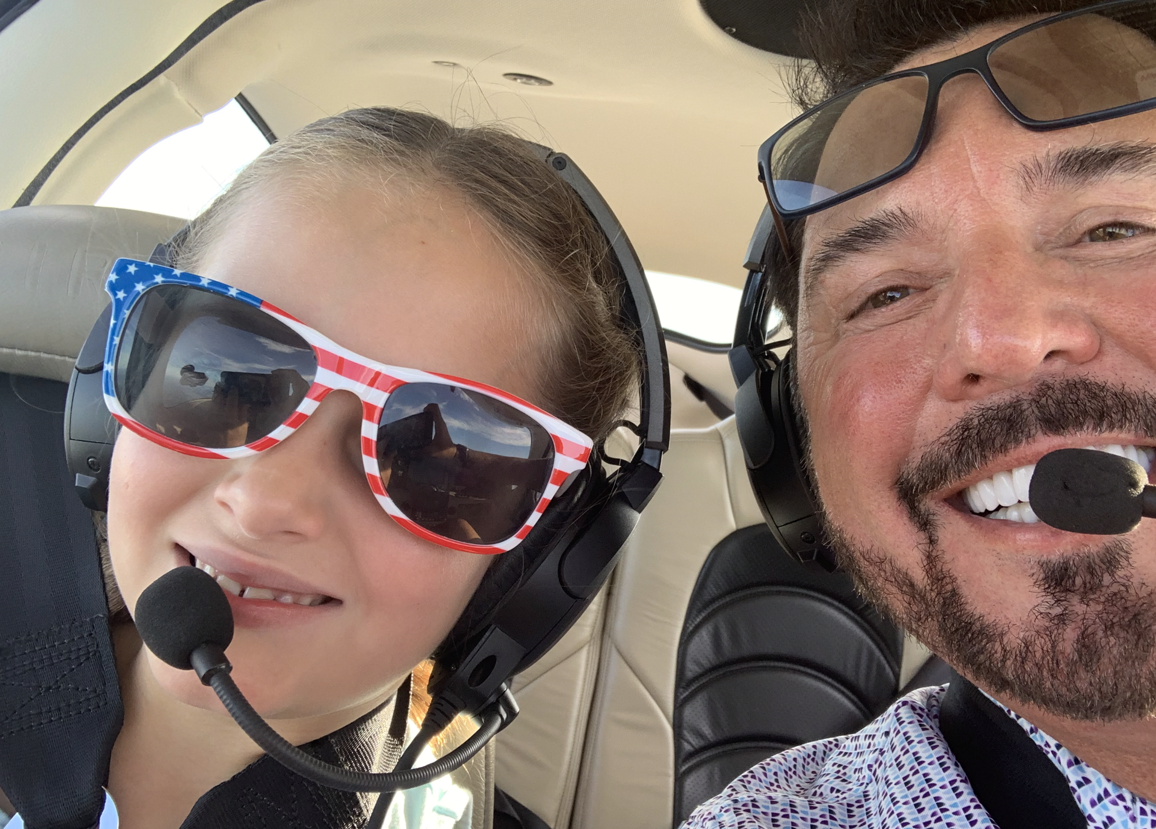 Flying the friendly skies with my granddaughter, Emma