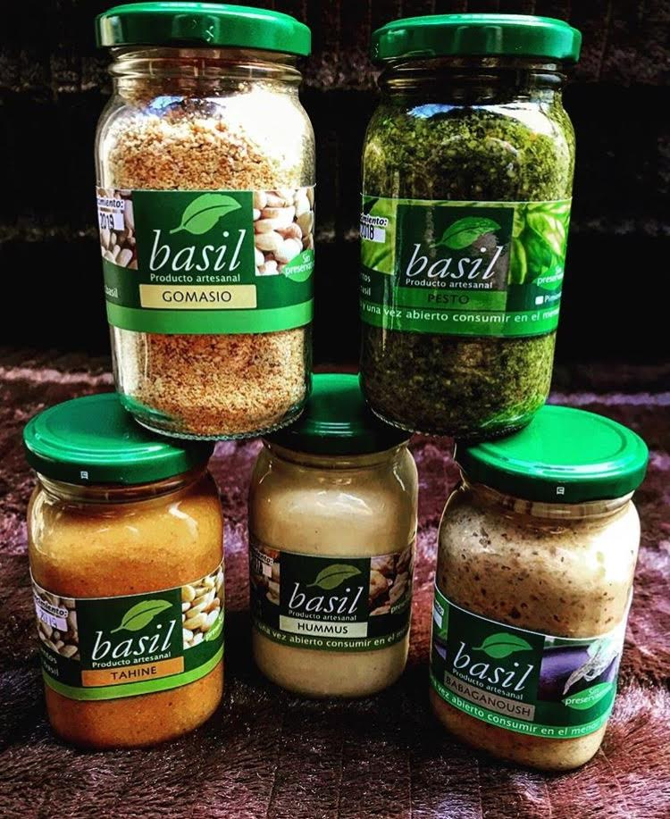 Image of all of the products offered by basil alimentos at the farmer's market.