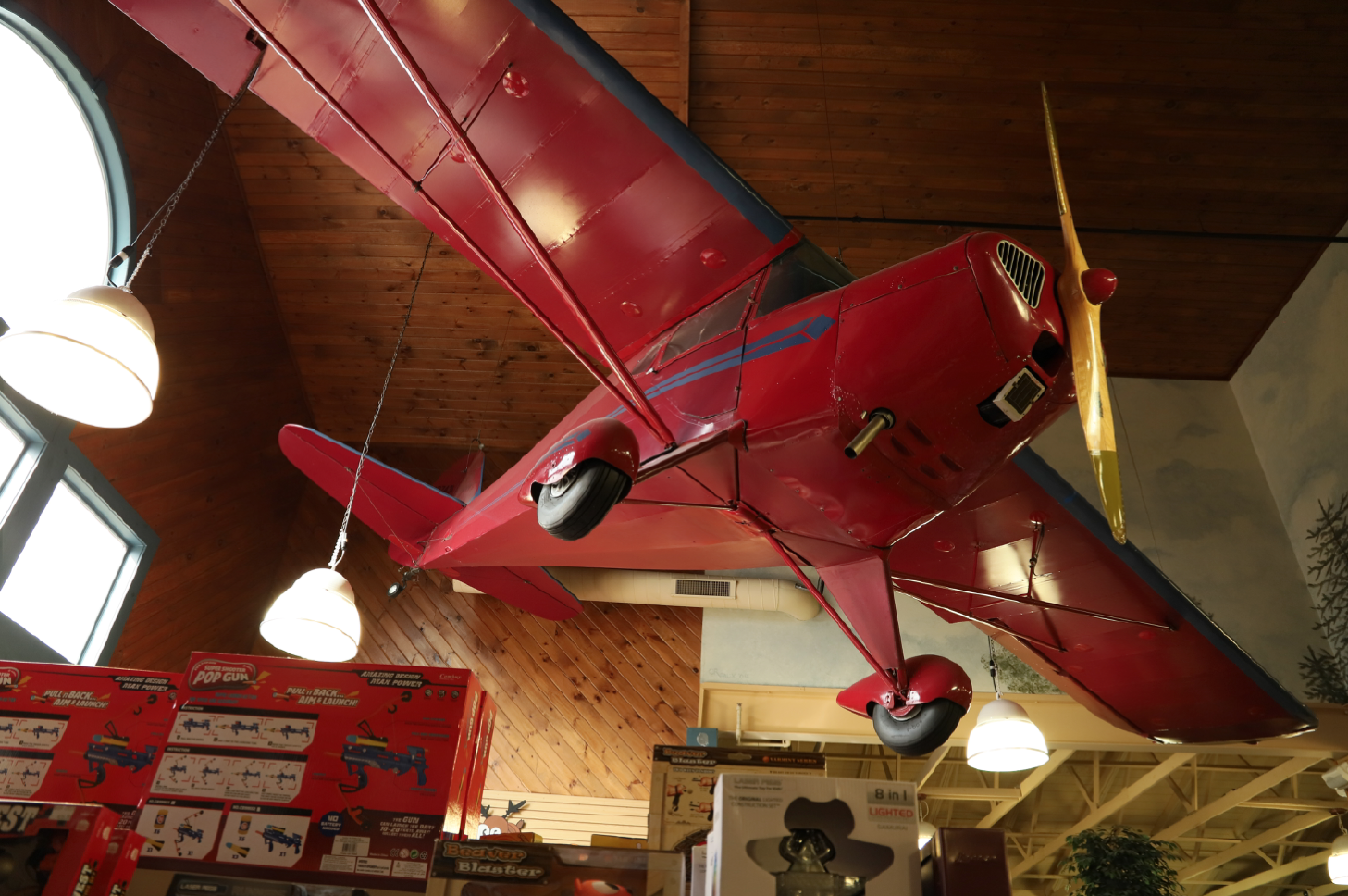 The RED BEARON! It's an actual airplane flying over the toy section!