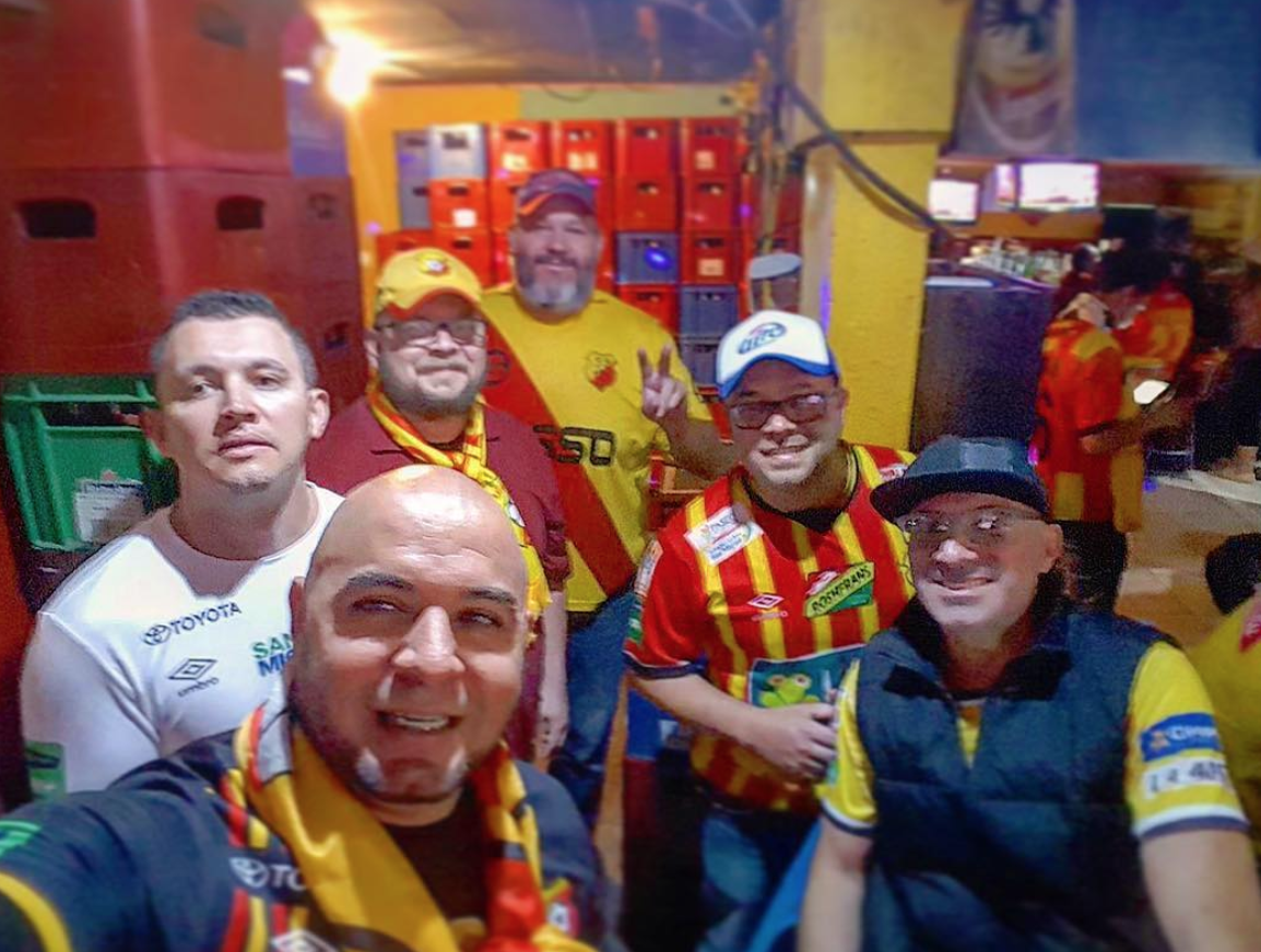 The author and friends before Club Sport Herediano vs. Las Pumas en a CONCACAF tournament.