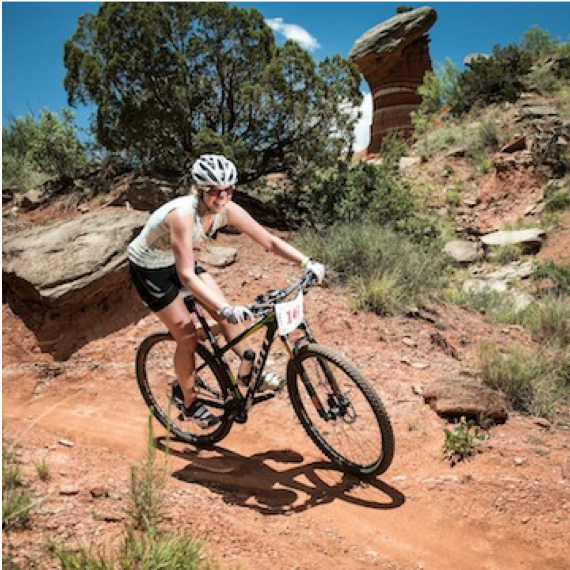 """Michelle """"Drum"""" Blackard (Dallas, TX)  Drum did the Leadville 100 mtb AND run. What?!?! Yep, that's right! She is more legit than you (and us for that matter). What's more important is she loves doing it and is always smiling!"""