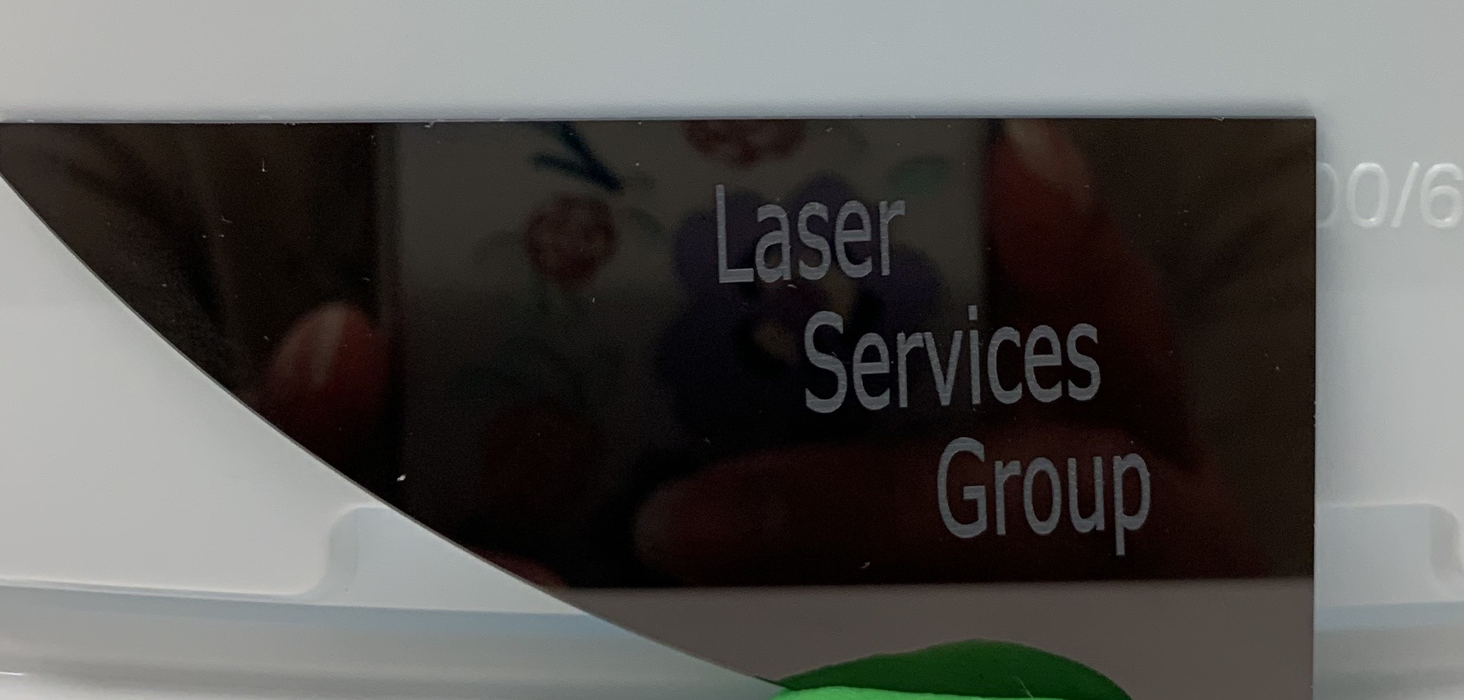 Laser marked characters on the surface of a polished silicon wafer. -
