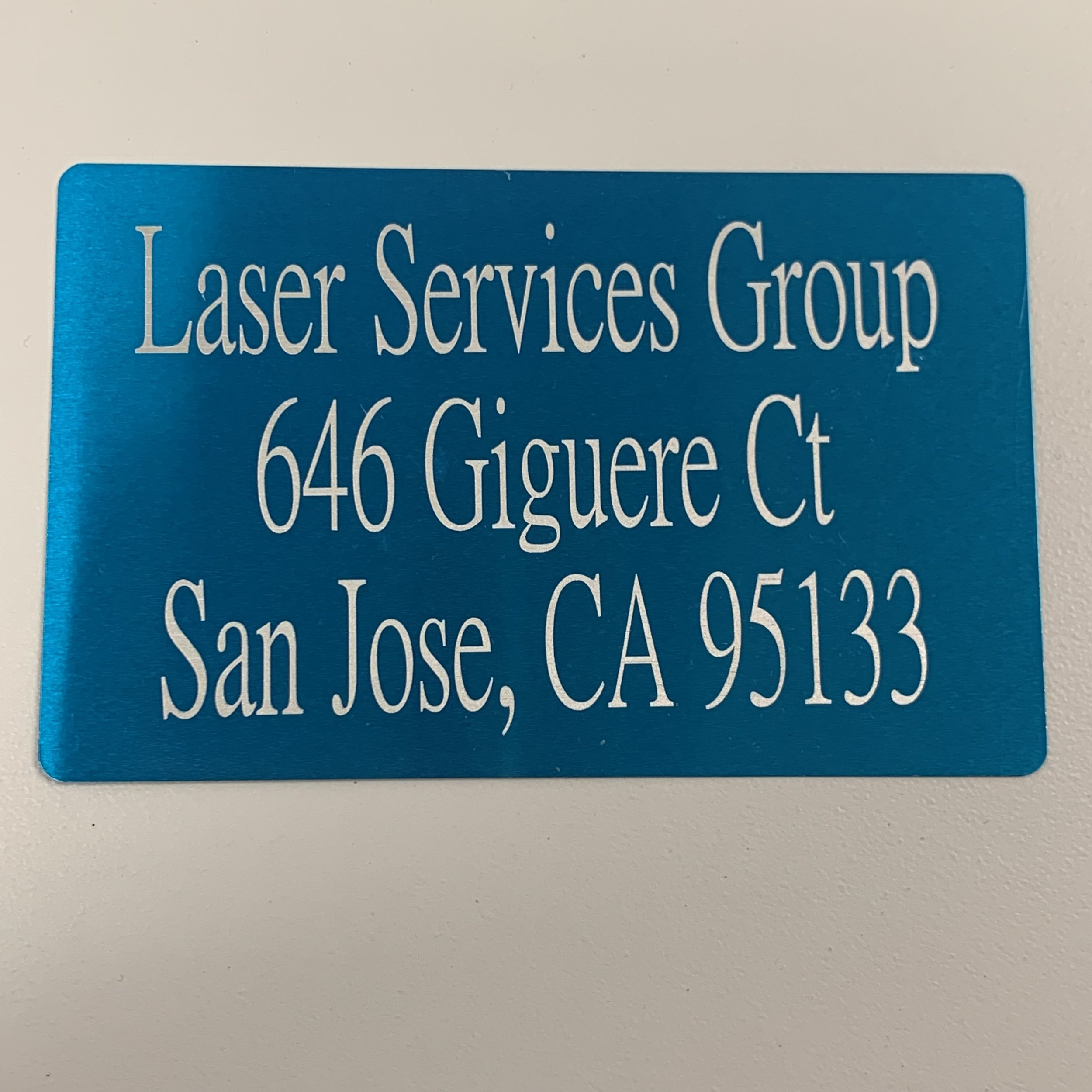 Laser marked characters on an anodized aluminum card. -