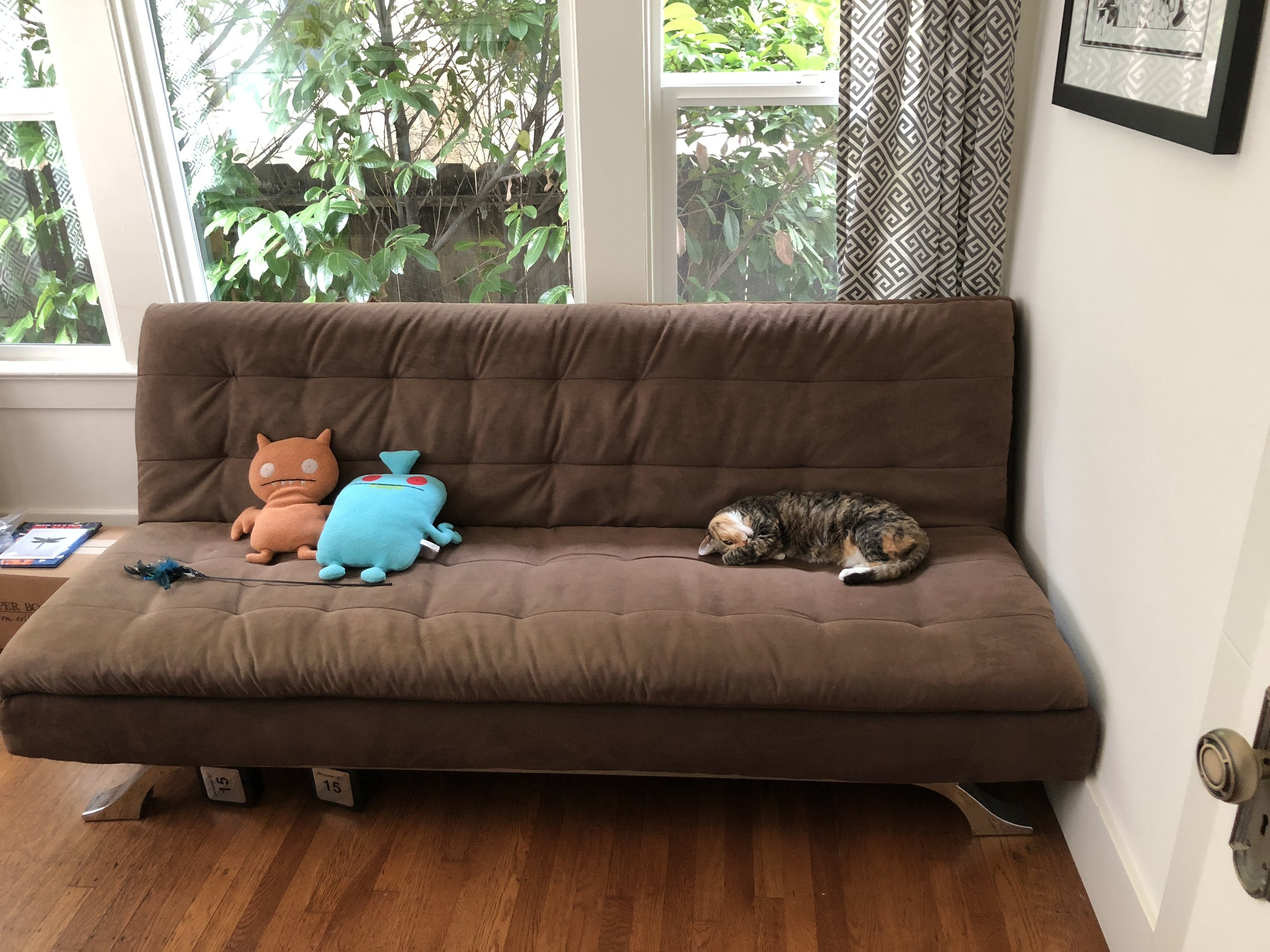 Kitty napping with a couple Uglydolls