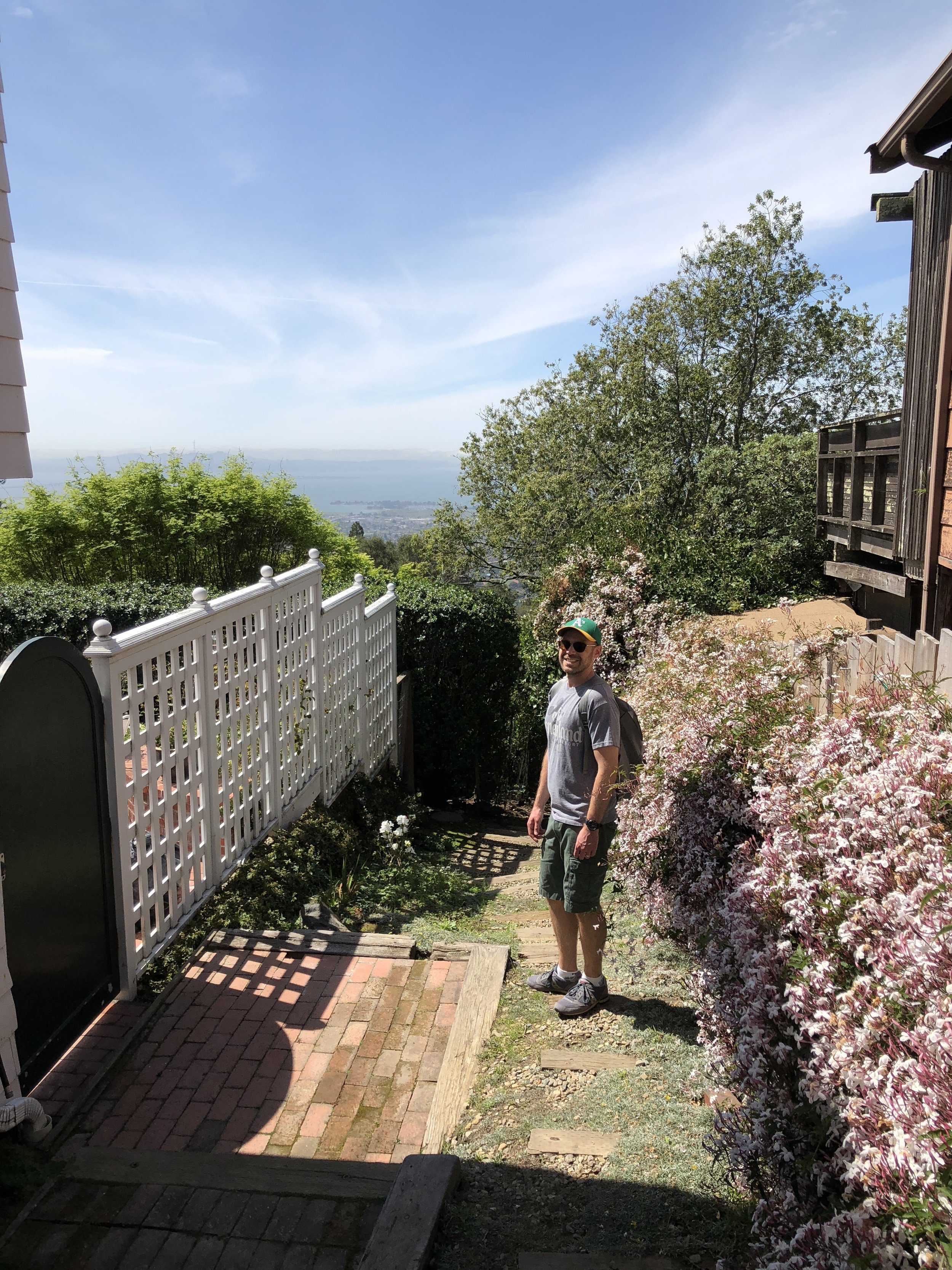 We went for a walk in the Berkeley hills. Here's Joseph walking down a path between two houses.