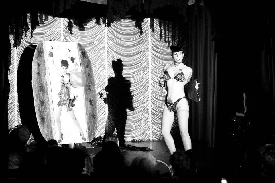 "Laxis of Evil - In this subversion of the traditional burlesque ""balloon pop"" act, Anna performs the world's only axe-throwing striptease. Yes! You read that right! Thrusting humor and sex into the circus art of knife-throwing; instead of popping her balloons with a pin, Anna throws axes at them. A dramatic striptease with a twist in the tail"