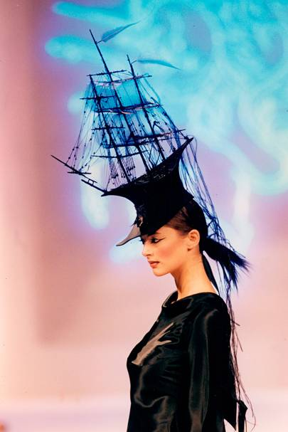 Model wearing Phillip Treacy' 'Ship' headpiece on the catwalk, 1994.  Image source.