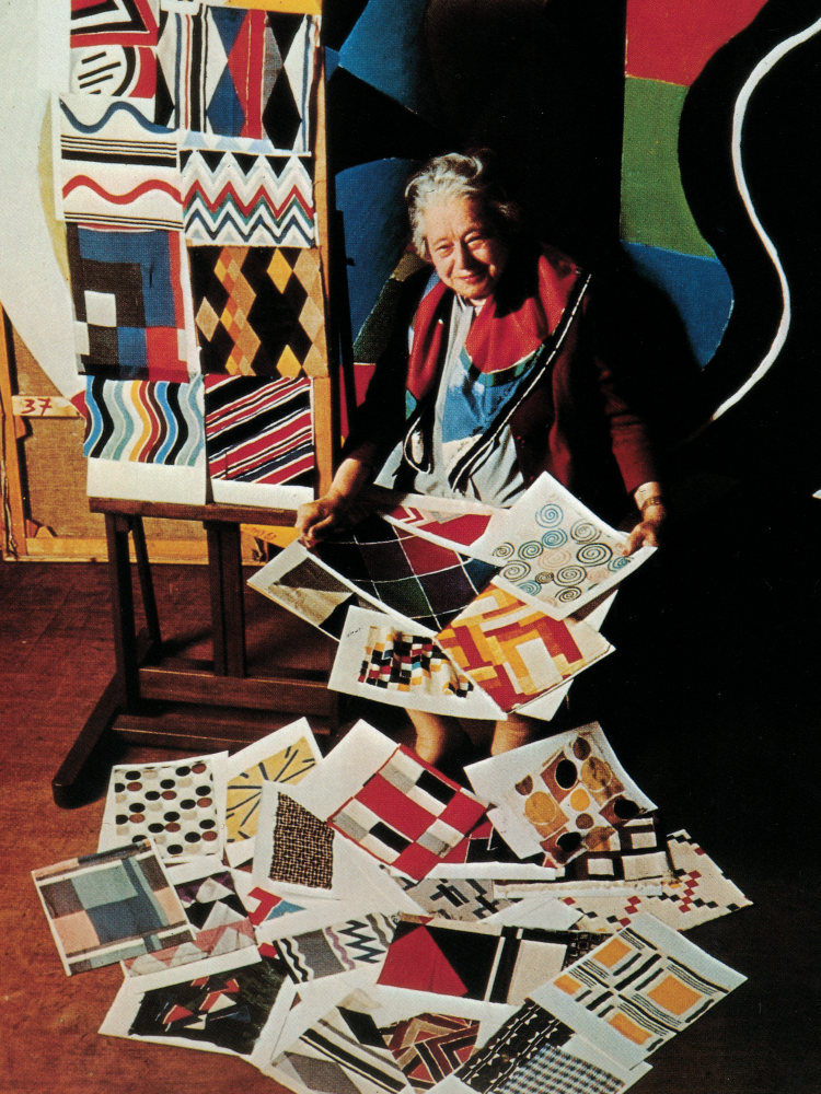 Sonia Delaunary surrounded by her designs, 1965