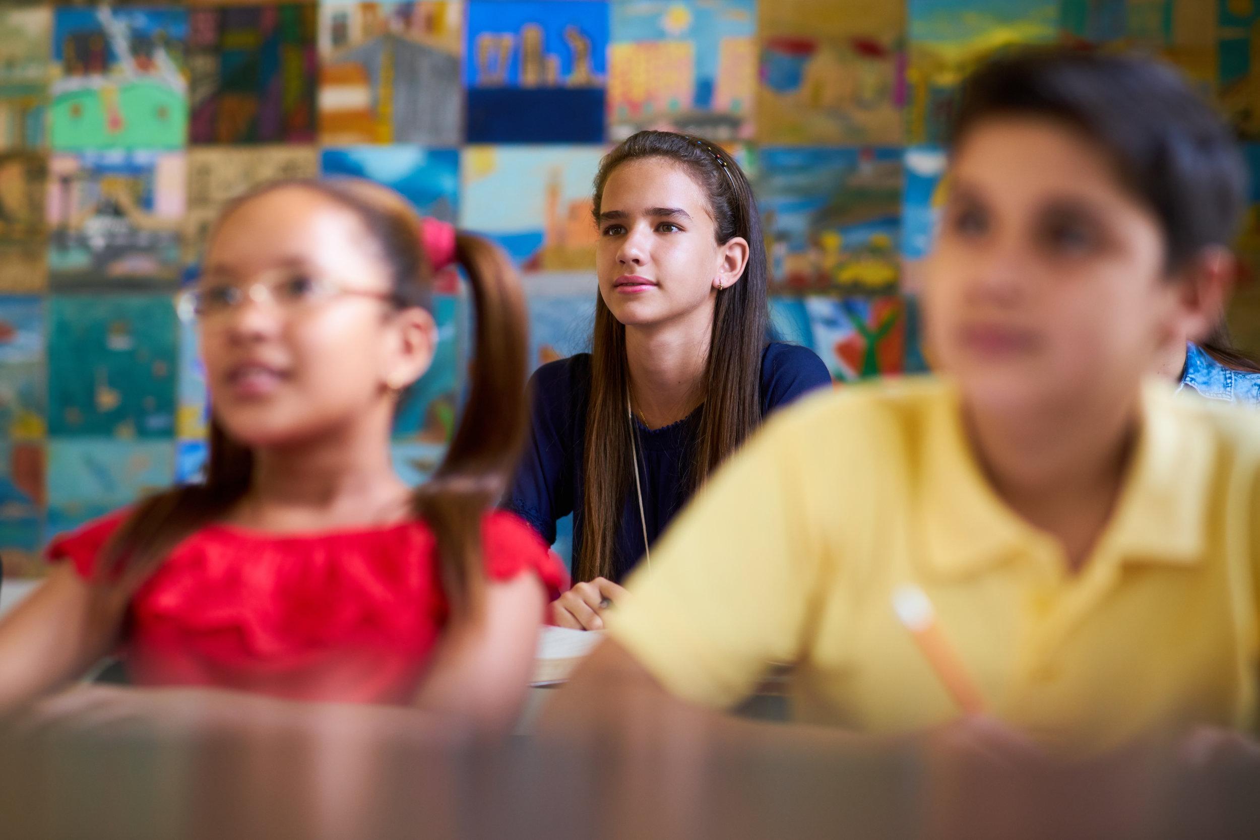 smart-girl-listening-to-teacher-at-school-PQV6SHN.jpg