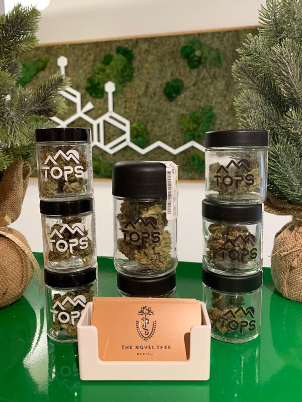 High Five Farms TOPS - This flower give people an extraordinarily economical alternative to high priced indoor cannabis. These sun grown kolas are packed with intense terpenes and stunningly high cannabinoid percentages. The growers at High Five believe that their sustainable outdoor method produces a product that is comparable to the finest indoor flower. Offerings like Beach Wedding hammer their point home. Available in eight and quarter ounces, this Oni Seed Co. classic contains a whopping 26.4% total cannabinoids. The tropical smoke produced by these dense buds is a full body relaxant that melts muscle cramps and sooths neuropathic pain.