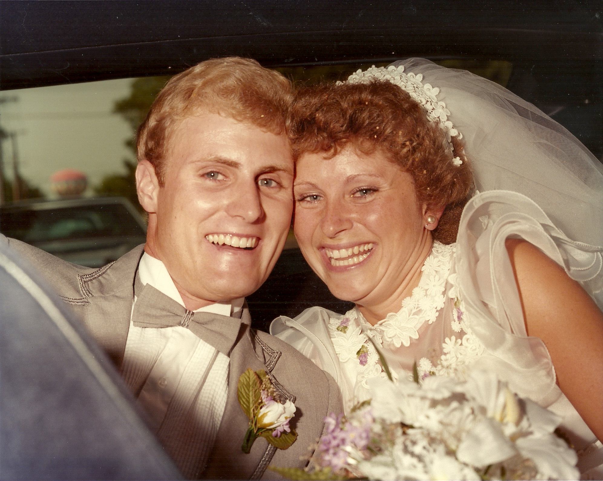 "Jerry + Janet Scanlan - Wedding Date: August 27, 1983Jerry is the 2nd oldest of 8 children + grew up in rural Ohio. Janet is the youngest of 3, also a Midwesterner, calling Peoria, IL home.Jerry + Janet met at the University of Notre Dame, the first day of their senior year. When he proposed, Jerry quoted Victor Frankl, from Man's Search for Meaning, ""The salvation of man is through love and in love."" When they got married, the mantra was: the wedding is a day, but the marriage is a lifetime. For them, the day wasn't the destination, it was the door. Janet recalls her wedding day saying,"