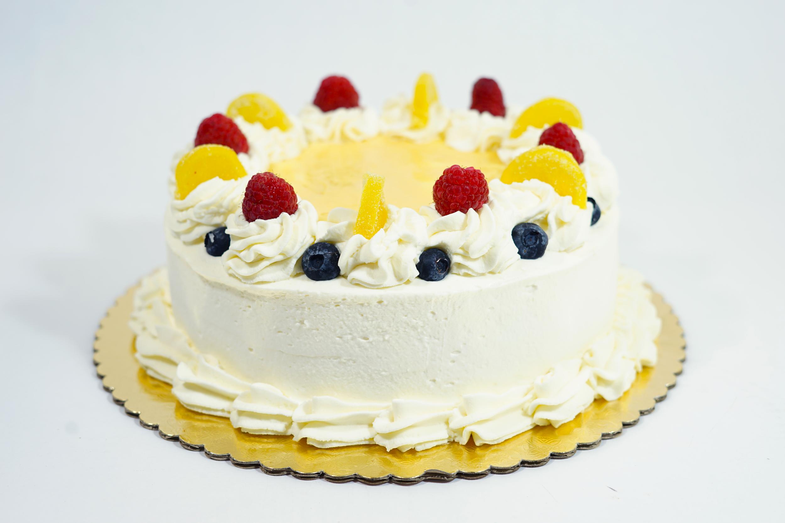 Lemon Seville - A white cake spritzed with lemon syrup and filled with lemon curd. Iced with a lemon mousse.