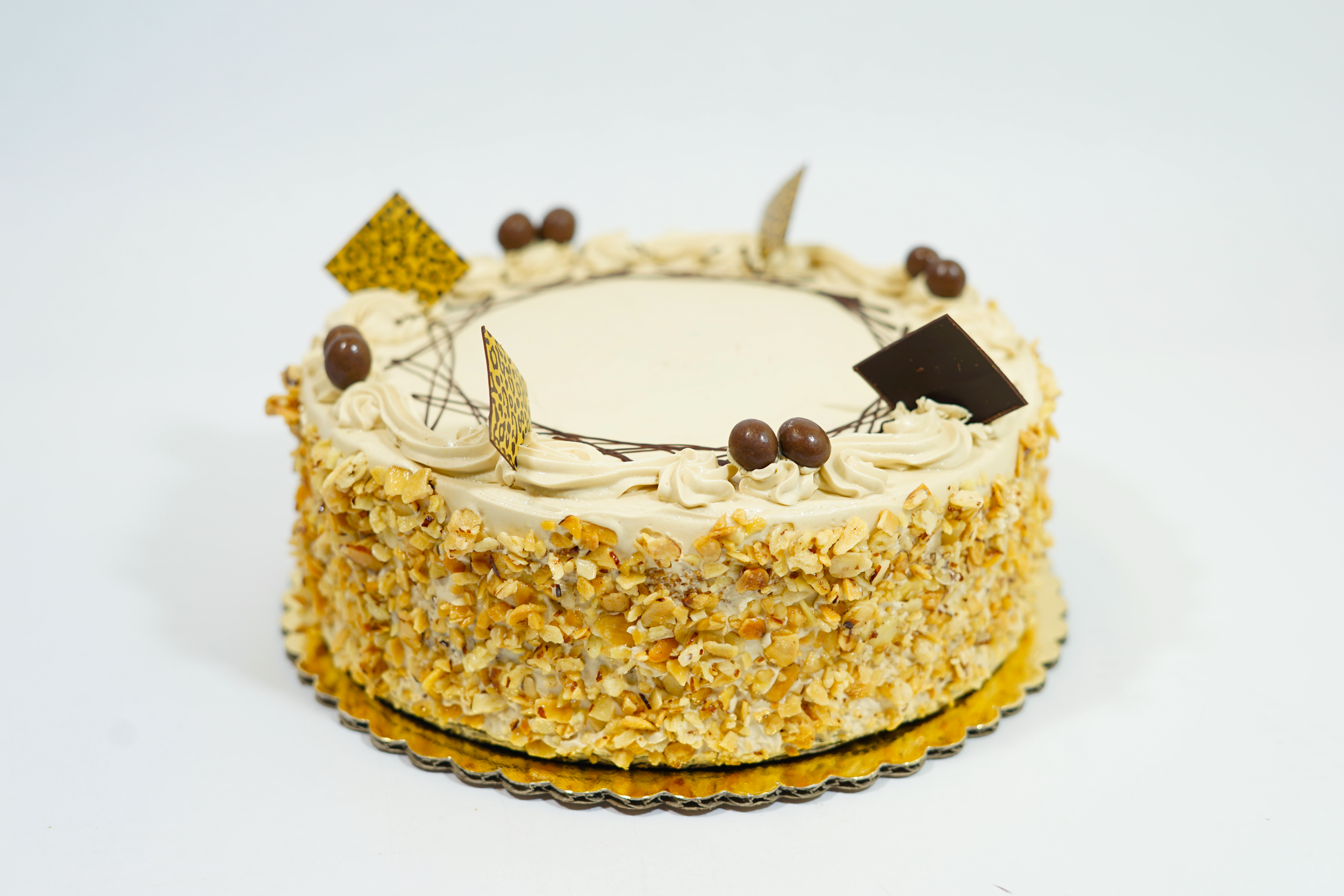Mocha - Genoise sponge cake with a chocolate ganache layer and coffee filling. Frosted with coffee flavored buttercream and decorated with croquant on the sides.