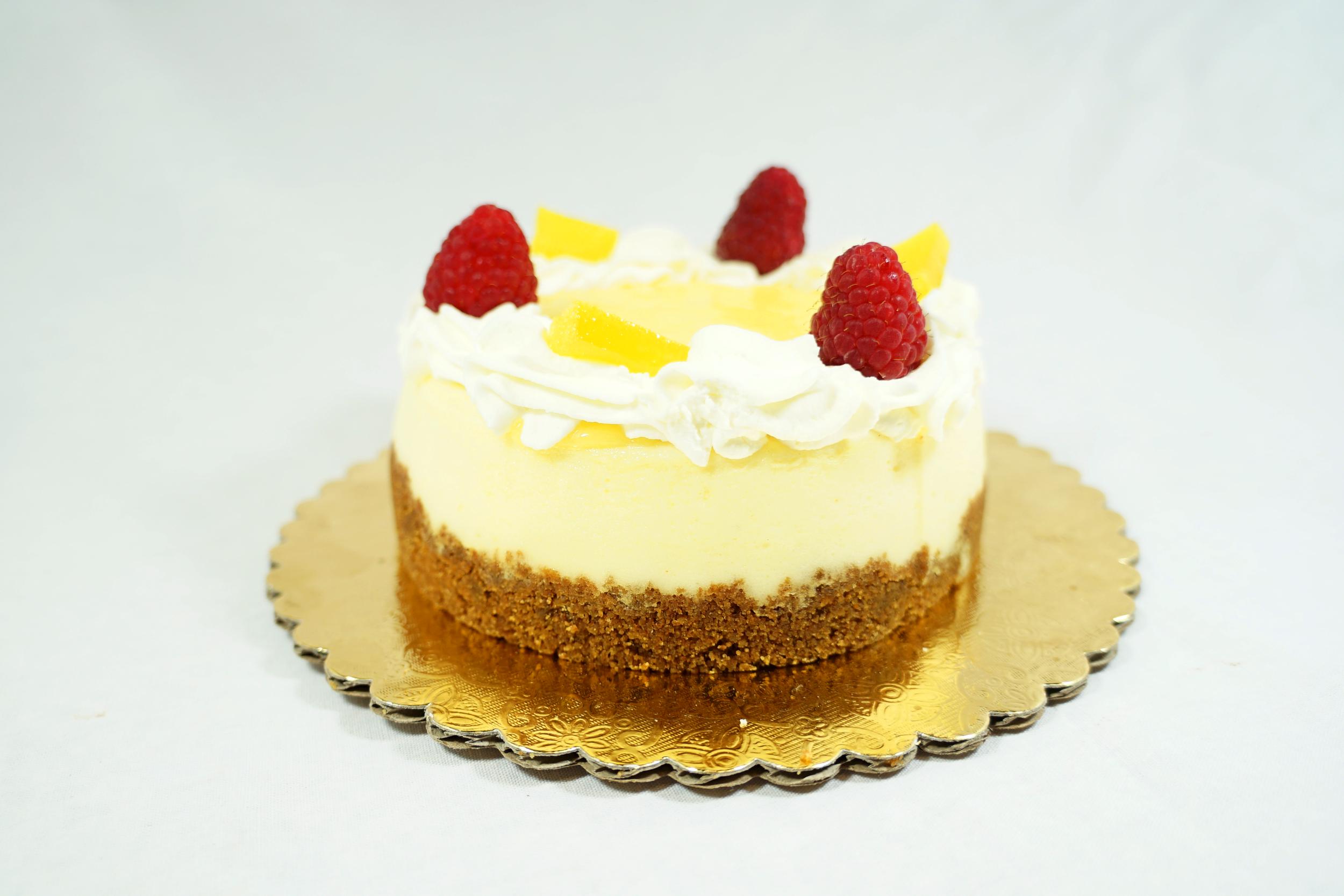 Lemon Cheesecake - Graham cracker crust with lemon curd topping.
